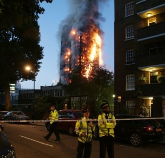 police-man-a-security-cordon-as-a-fire-engulfs-the-grenfell-tower-in-west-london